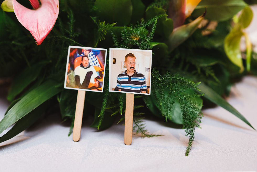 pictures of the grooms printed on paper and stuck to popsicle sticks on the table during wedding ceremony at the Hilton Fallsview in Niagara Falls