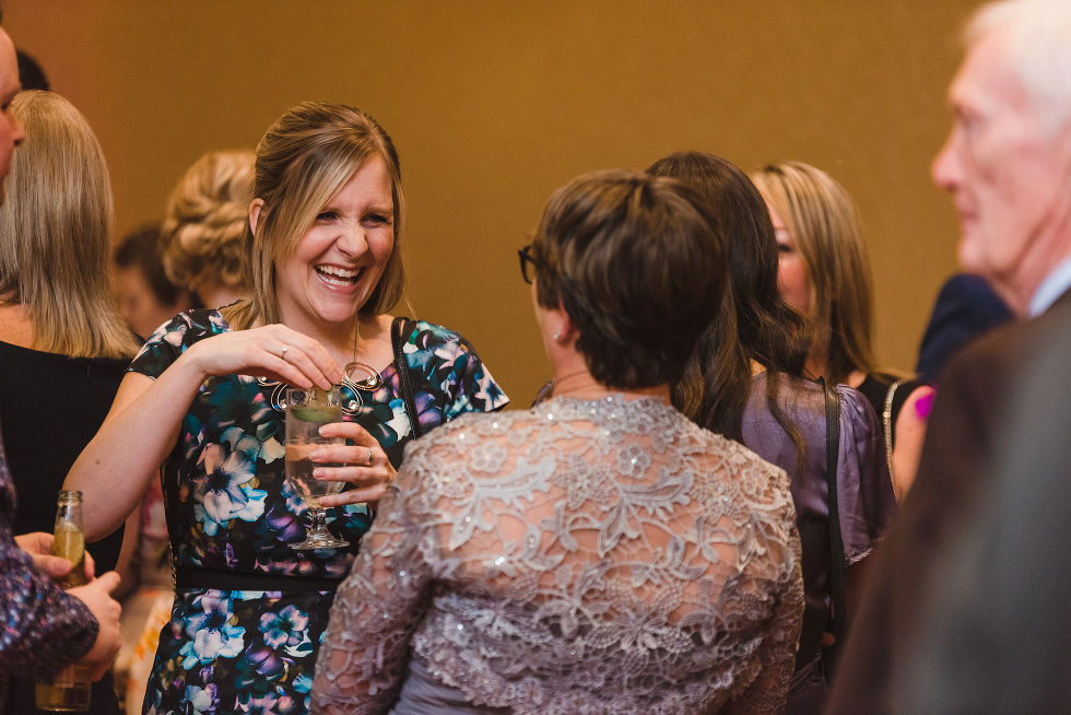 wedding guests laughing during cocktail hour at the Hilton Fallsview in Niagara Falls
