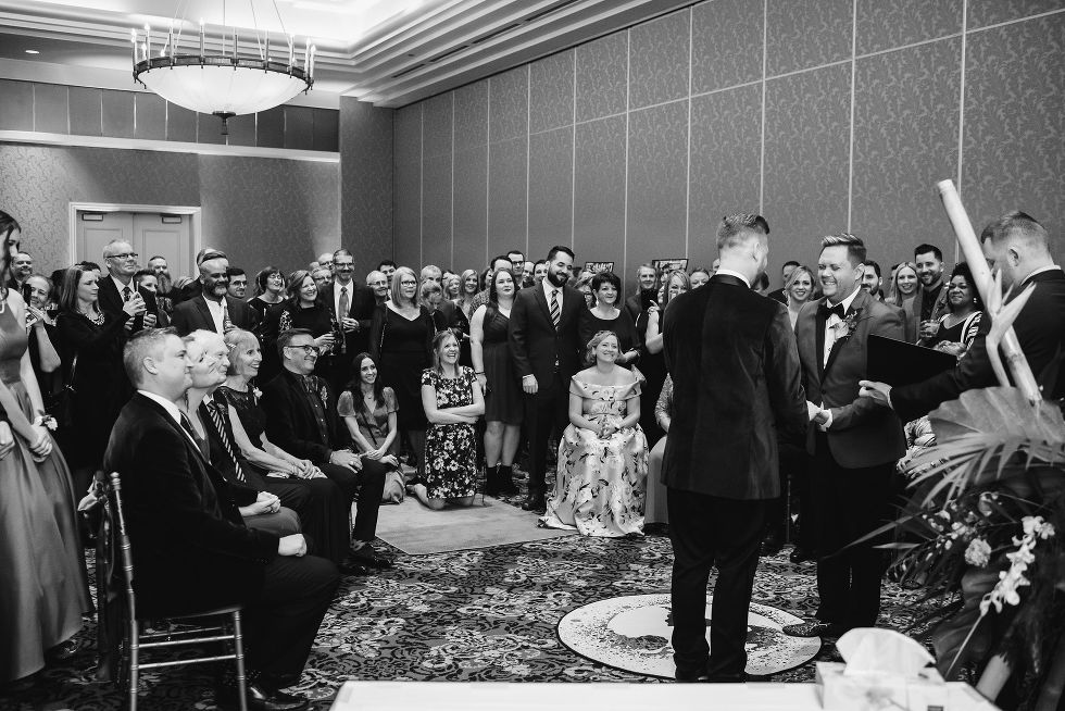 banquet hall filled with wedding guests watching ceremony at the Hilton Fallsview in Niagara Falls