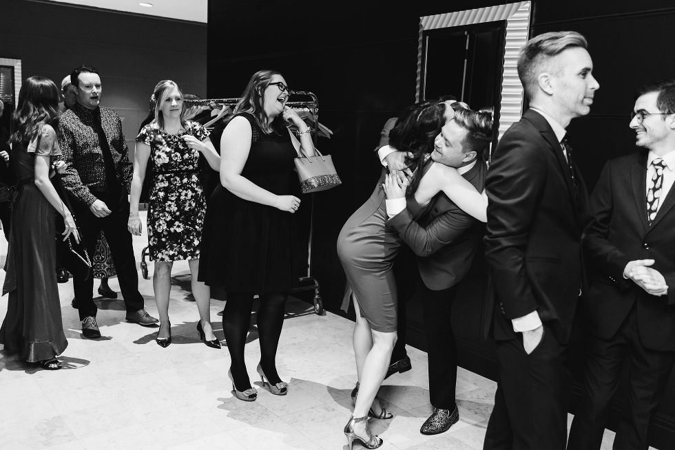 groom hugging one of his wedding guests after the ceremony at the Hilton Fallsview Casino in Niagara Falls