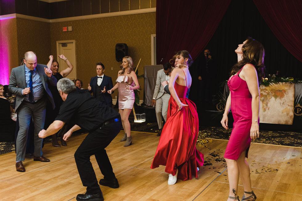 wedding guests dancing during a fun wedding reception at the Hilton Fallsview in Niagara Falls