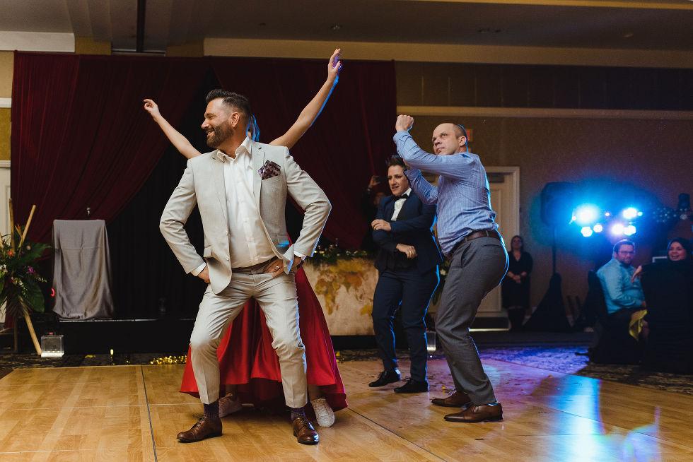 guests dancing during a fun wedding reception at the Hilton Fallsview in Niagara Falls