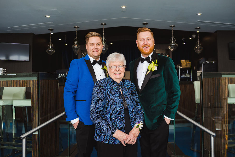 Grooms standing behind the grandmother before wedding ceremony at the Hilton hotel in Niagara Falls