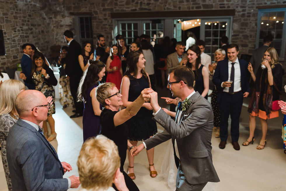 groom on the dance floor dancing with his wedding guests during his charming southern style wedding at Ruthven National Historic Site near Hamilton