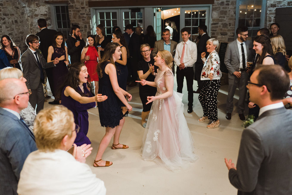 bride on the dance floor dancing with her wedding guests during her charming southern style wedding at Ruthven National Historic Site near Hamilton