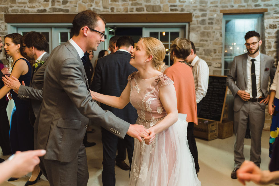 bride and groom laughing and dancing with their guests during their charming southern style wedding at Ruthven National Historic Site near Hamilton