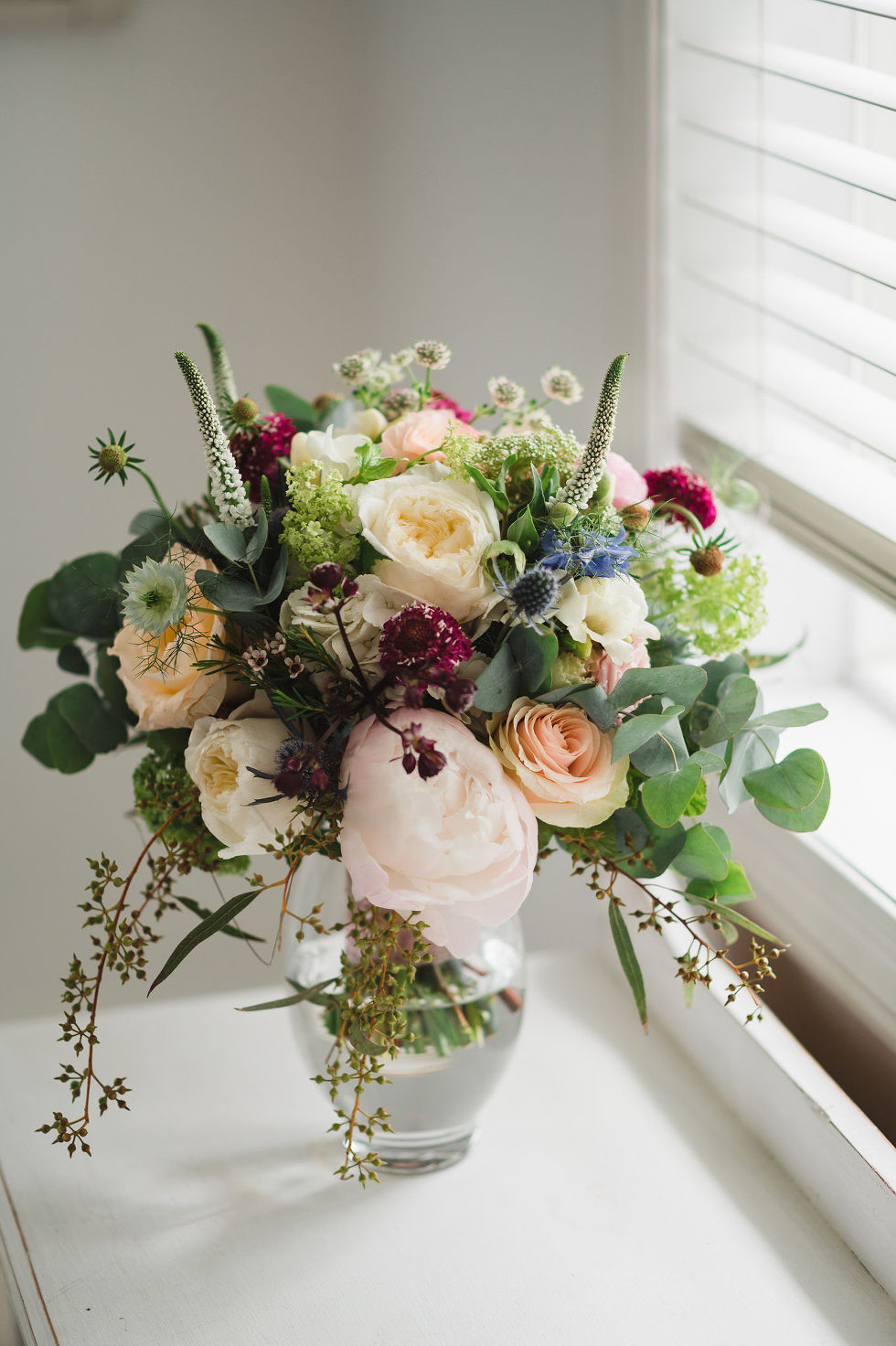 colourful floral bouquet in windowsill before a charming southern style wedding at Ruthven Park National Historic Site