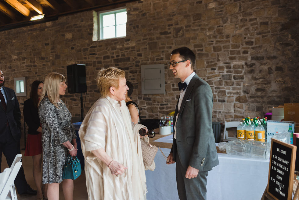 groom greeting guests before his charming southern style wedding at Ruthven Park National Historic Site