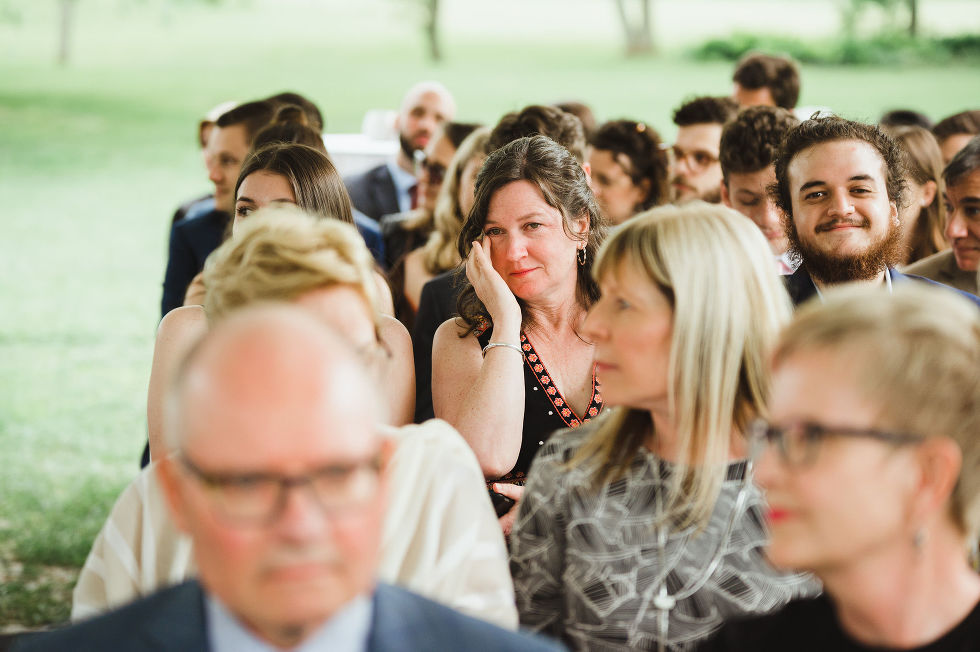 wedding guests emotionally watching a charming southern style wedding at Ruthven Park National Historic Site near Hamilton Ontario