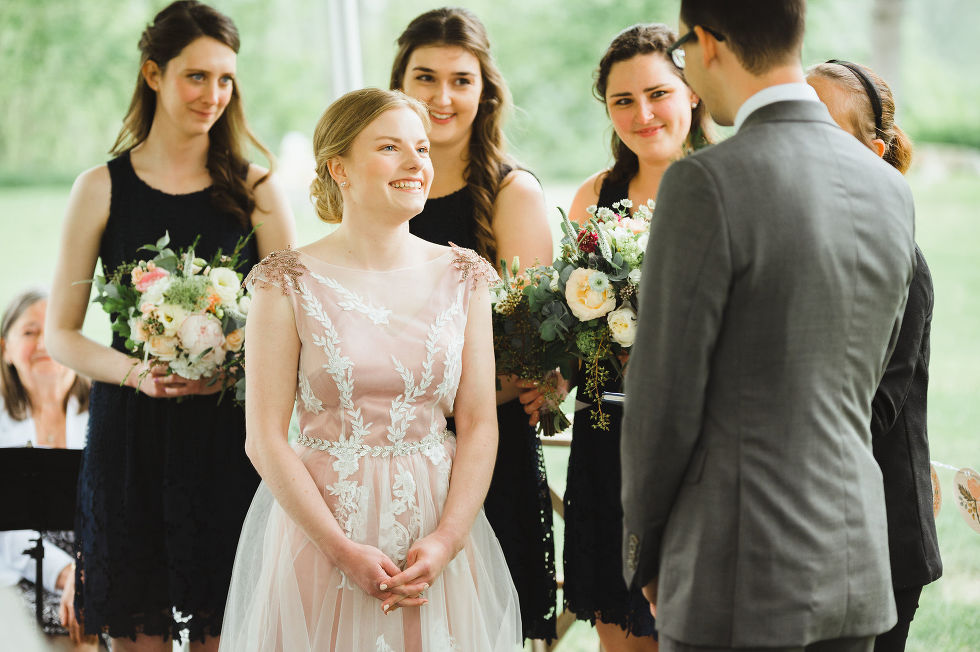 bride smiling at her groom during their charming southern style ceremony begin at Ruthven national historic site