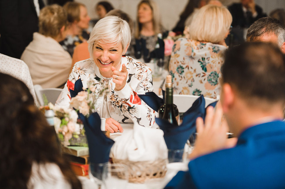 wedding guests laughing at their table during a charming southern style wedding at Ruthven National Historic Site near Hamilton